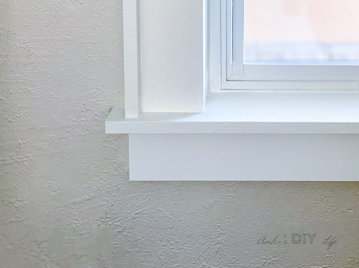 close up of corner of window with DIY trim