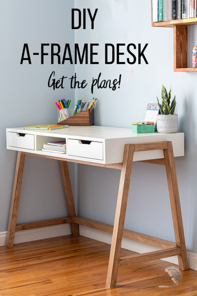 DIY A-frame desk in room with accessories on top.