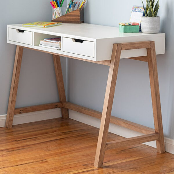 Learn how to build this DIY A-frame desk with drawers. This simple yet stylish wood desk is easy to make and makes any home office pop! Plus it uses only 4 power tools!