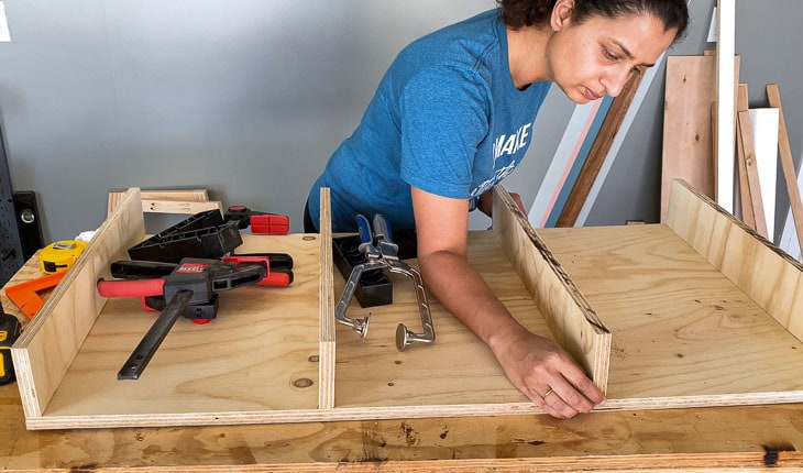 woman building the top frame of the desk