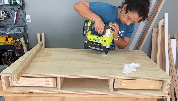 Attaching the top of the desk using brad nailer