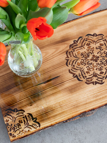 Learn how to make a gorgeous DIY Mandala Tray using wood burning with a heat-sensitive pen and blowtorch. Its a quick project and takes a couple of hours!