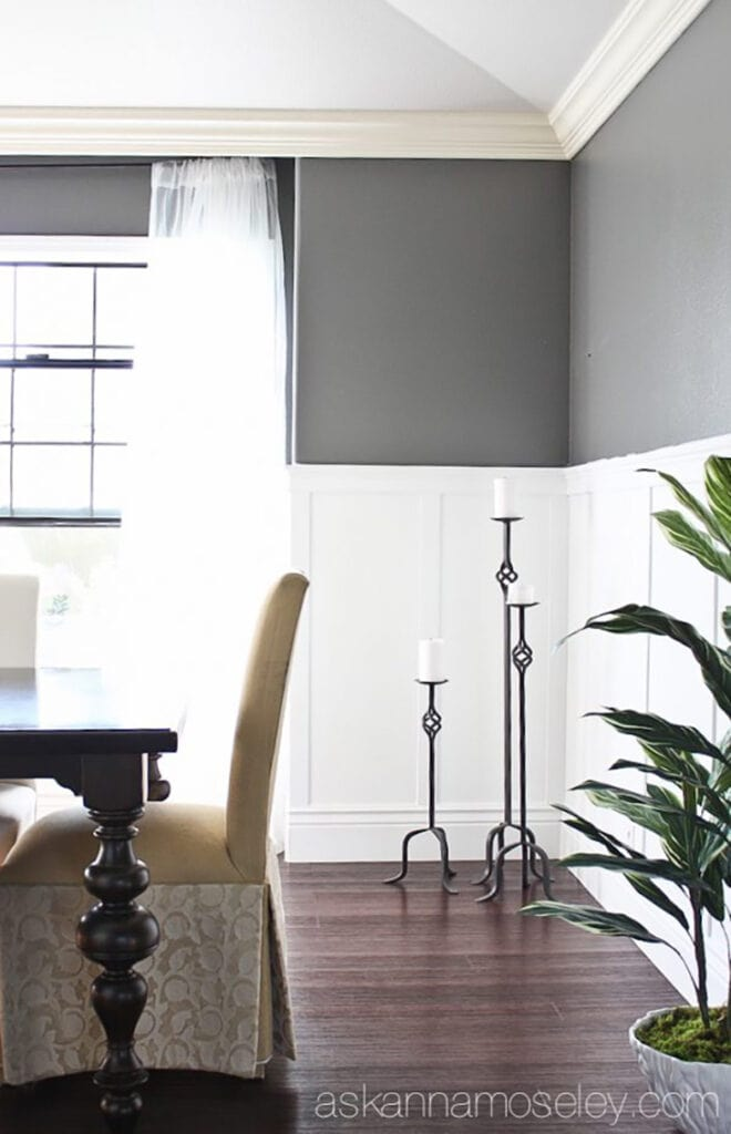 white half wall board and batten in dining room with gray walls