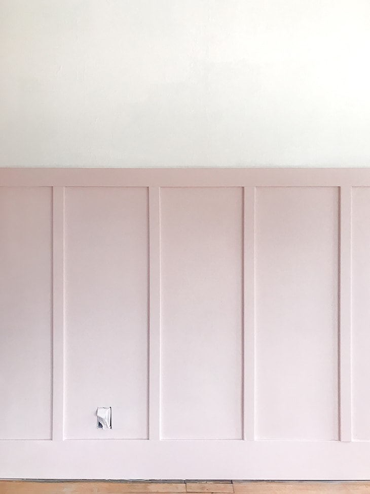 pink board and batten wall in an empty room