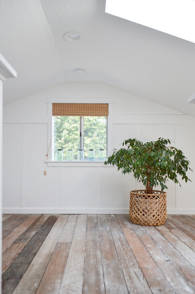 white board and batten wall in a room with vaulted ceiling