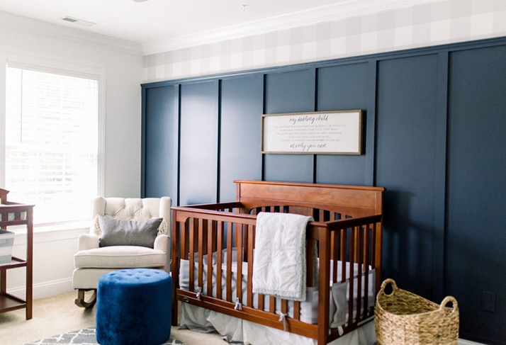 Nursery with Navy board and batten wall and grey gingham wallpaper on top