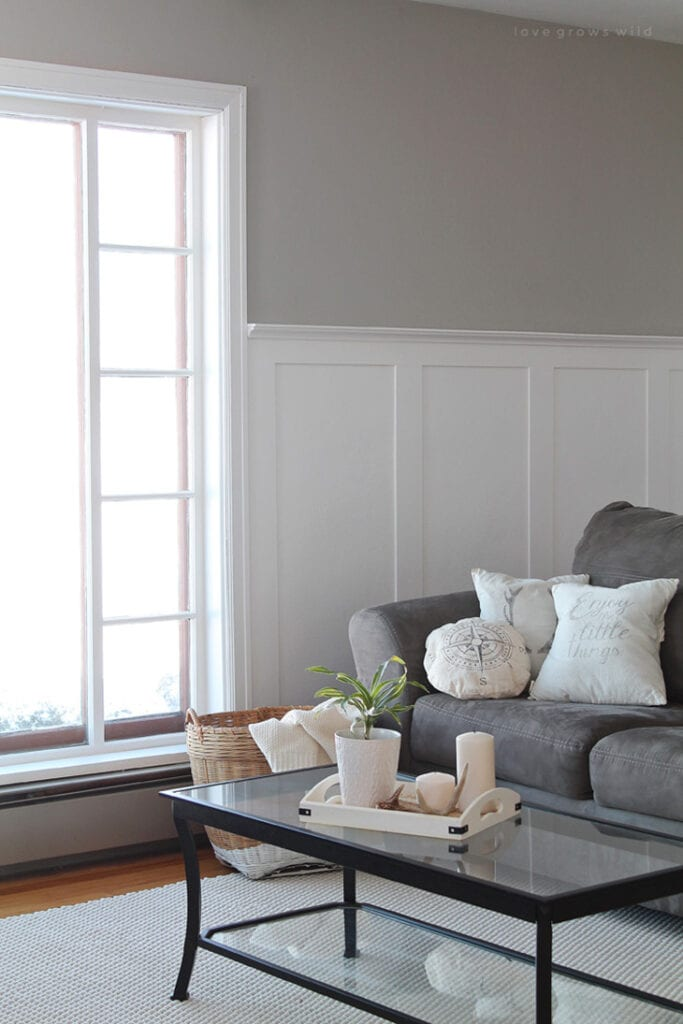half baord and batten wall in living room with gray couch