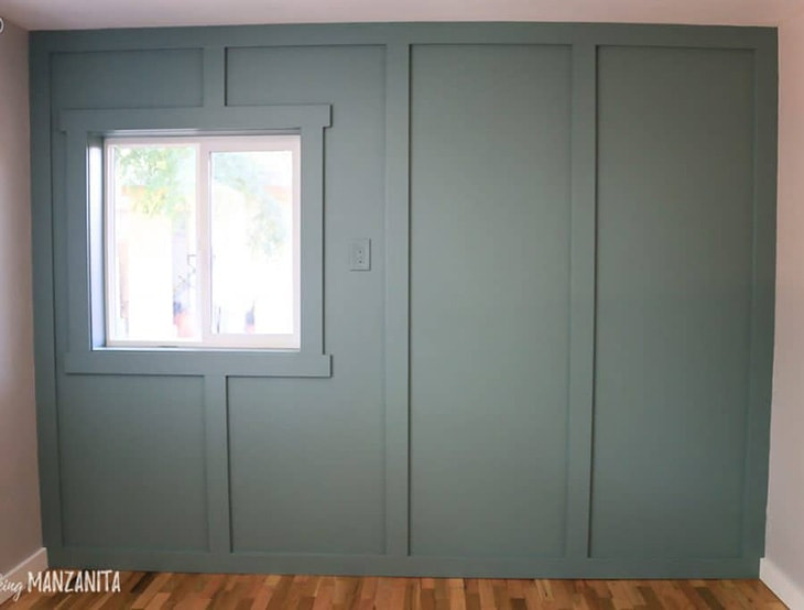 Dark gray board and batten full wall in a small room empty