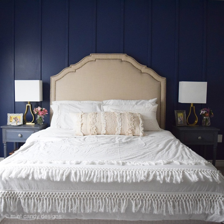 Bedroom with navy board and batten accent wall using thin boards
