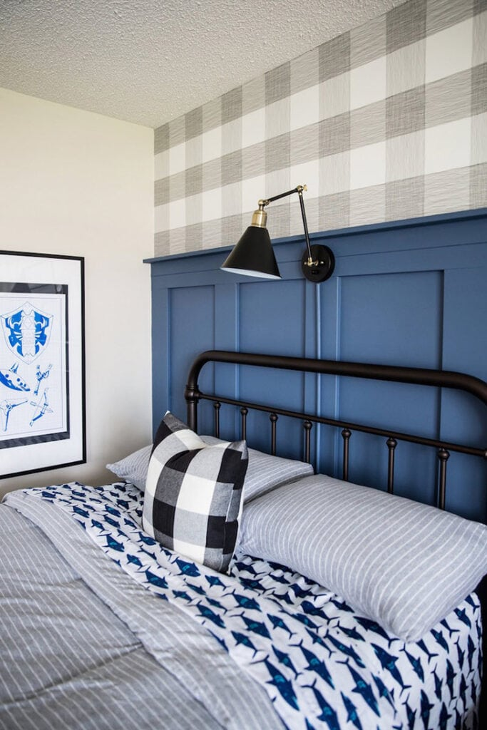 blue half wall board and batten in boy room.