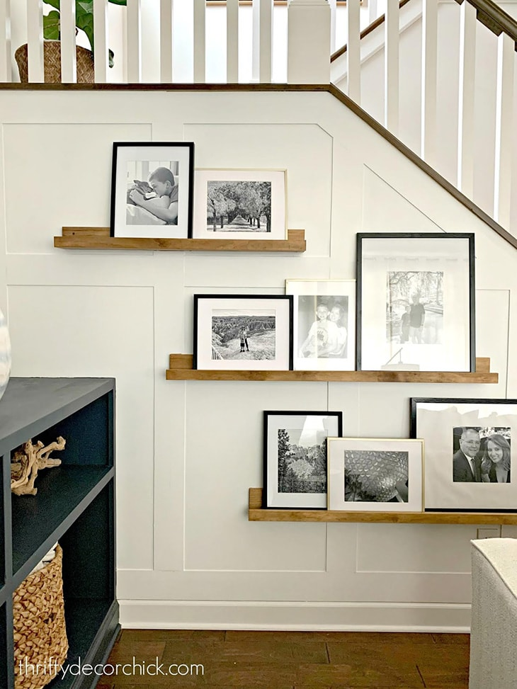 white board and batten on stair wall with picture ledges