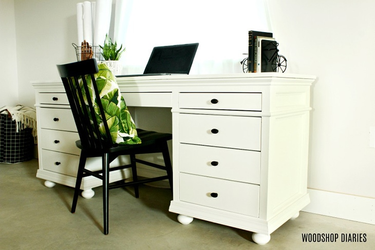 Traditional style desk with storage painted white with bun feet