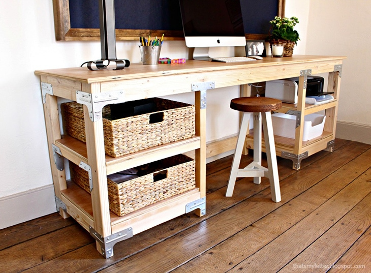 Industrial workbench inspired desk with open shelving and metal accents on the corners