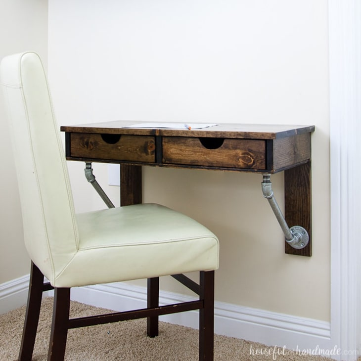 DIY wall mounted industrial desk with pipe detail and two drawers