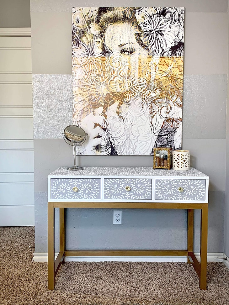 DIY vanity desk with 3 drawers with glass knobs and stenciled surface