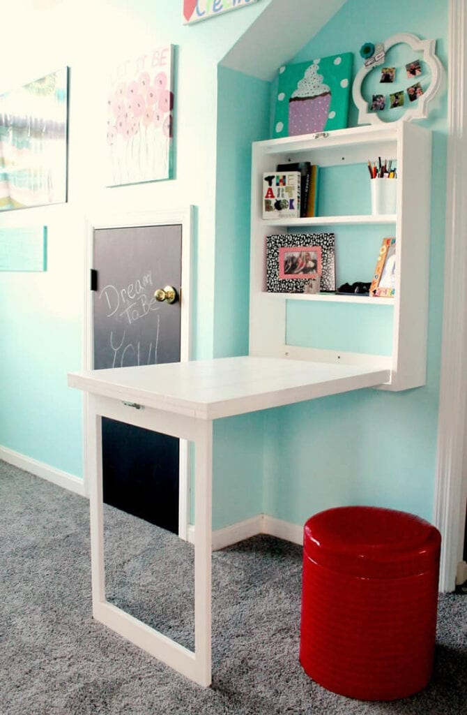 DIY white Murphy desk with shelves inside for storage