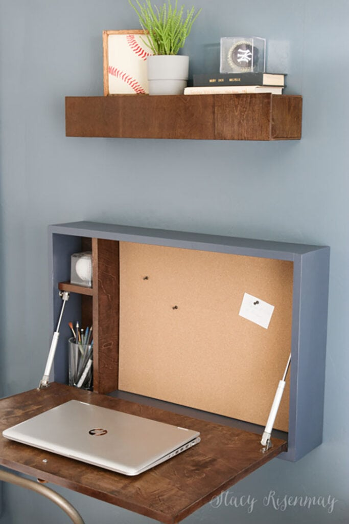 Fold down desk with storage and bulletin board inside