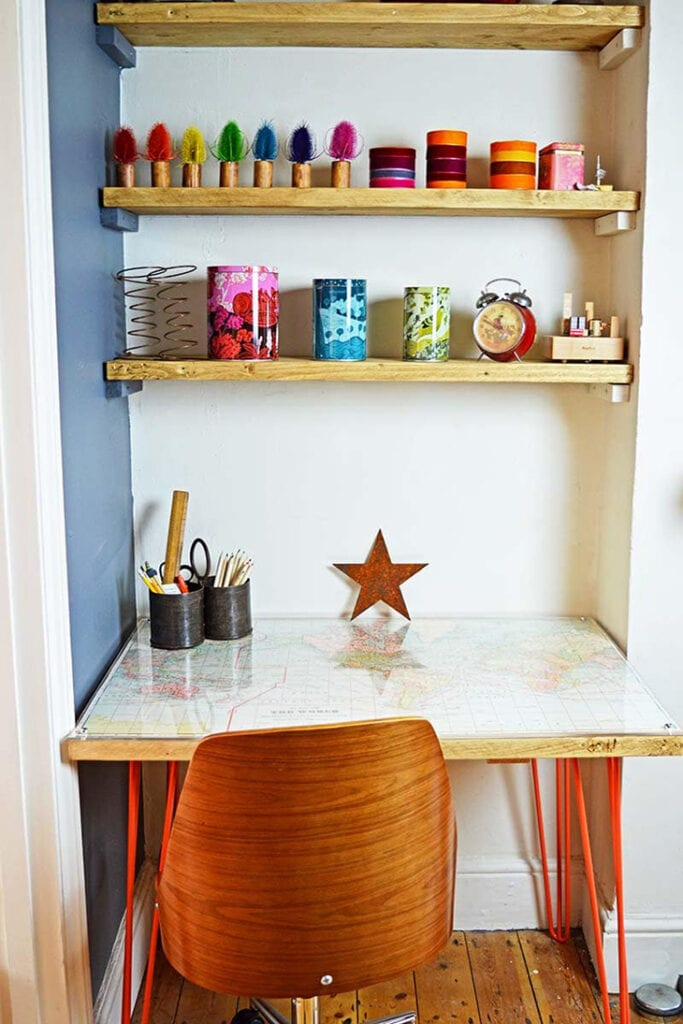 DIY desk with red hairpin legs and world map on the top