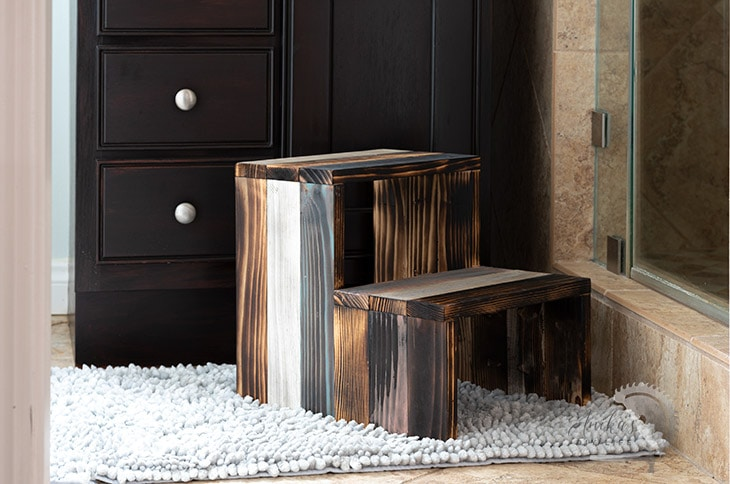 DIY wooden step stool in bathroom