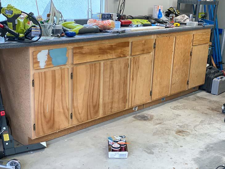Wood veneer cabinets in garage before painting.
