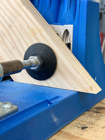Learn how to make pocket holes in angled boards using a Kreg Jig. Get all the details using pocket holes in miter and bevel joints.