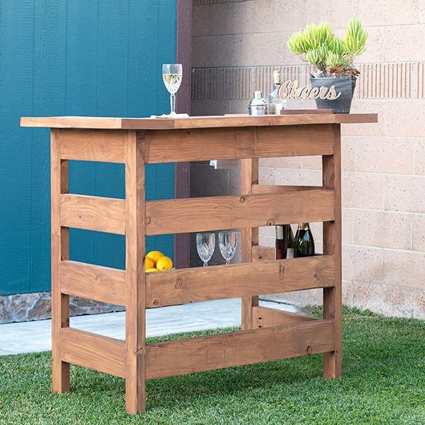 Learn how to build a wooden DIY outdoor bar perfect for any deck, patio or porch with step by step tutorial, plans, and video.