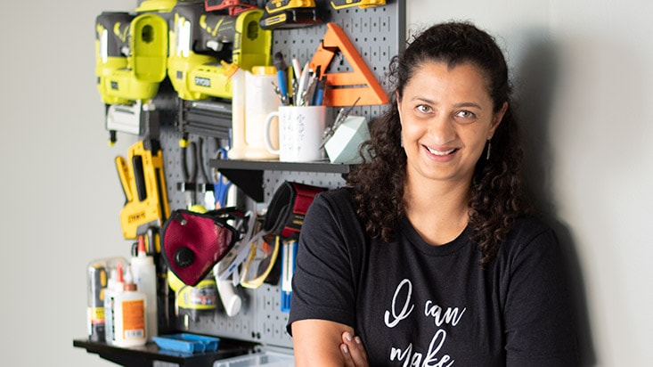 woman standing in front of a tool wall