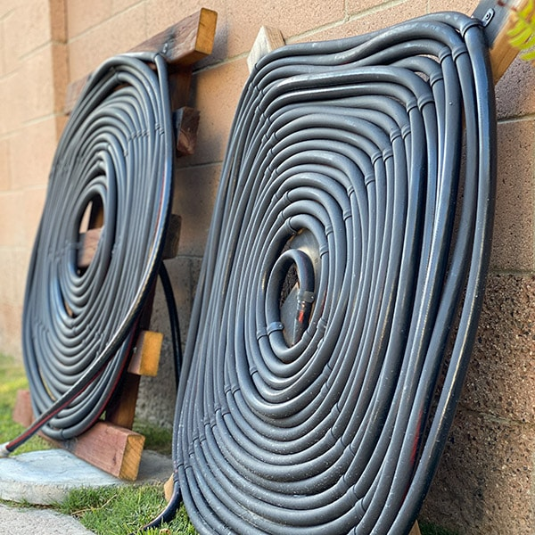 Learn how to make a DIY solar pool heater using inexpensive material in a weekend. This complete step by step tutorial and video is perfect for beginners.