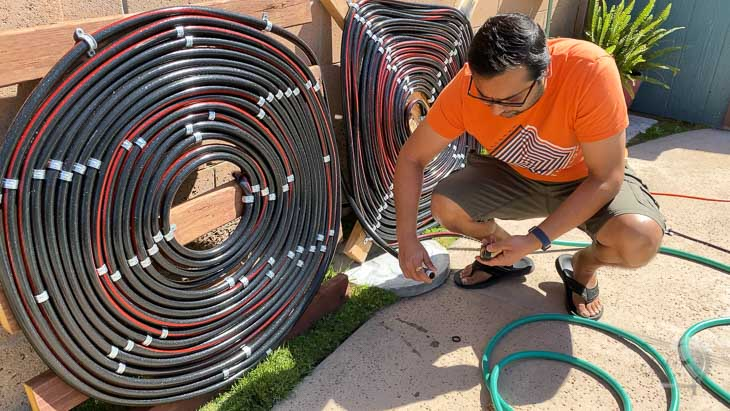 man connecting hoses together