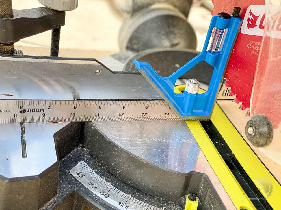 using a combination square to align the table on a miter saw