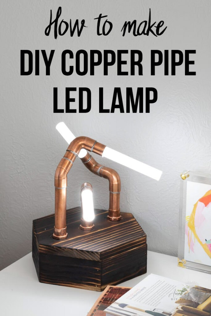 DIY copper pipe lamp with acrylic rods on a desk with text overlay