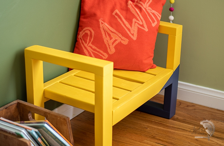 close up of yellow and navy blue bench
