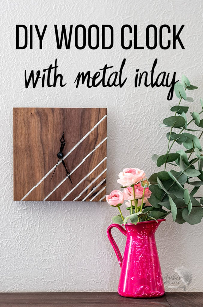 DIY wood clock with metal inlay on wlal next to pink roses with text overaly