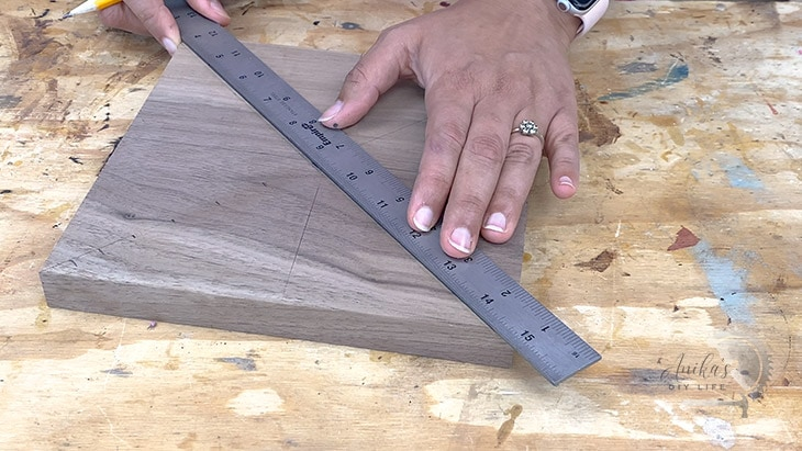 marking locations of metal inlay on the wood clock