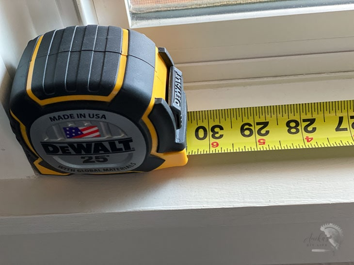 measuring a window using number on tape measure case