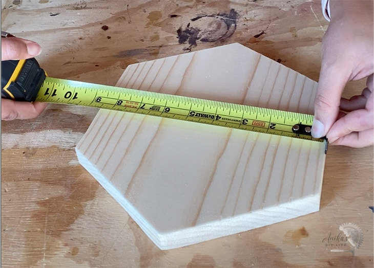 using the tape measure so tab is extended out