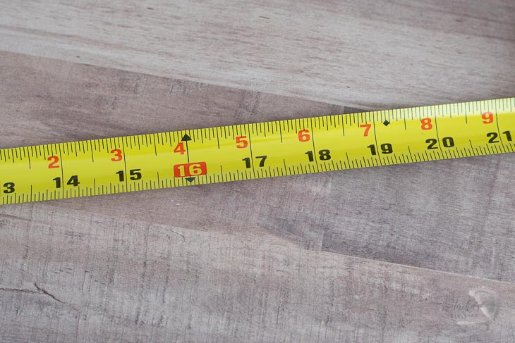 black diamond and red square on tape measure
