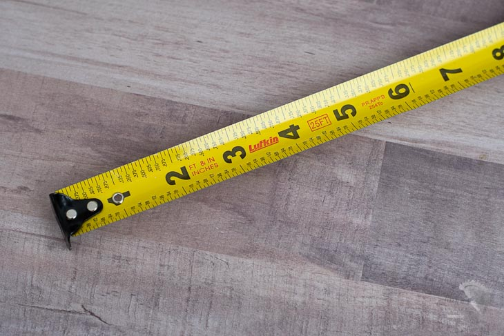 Tape measure with fractions and decimals marked