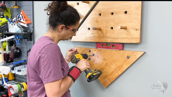 Attaching magnetic plywood to the wall