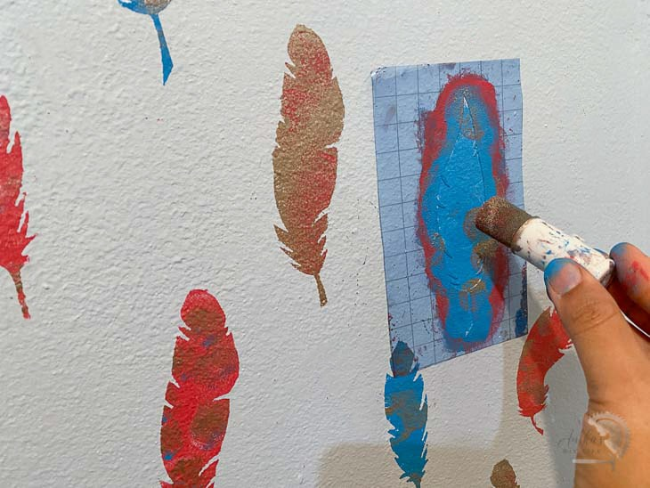 mixing up colors on the stenciled wall pattern