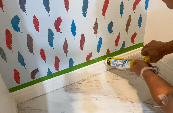 using a masking tape for the perfect caulking line