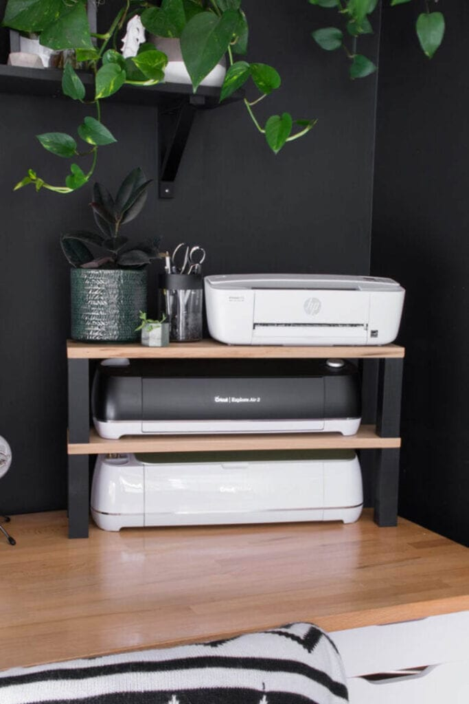 printer stand sitting on desk with Cricut machines on the shelves