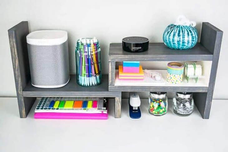 expandable desk top organizer with desk supplies on it