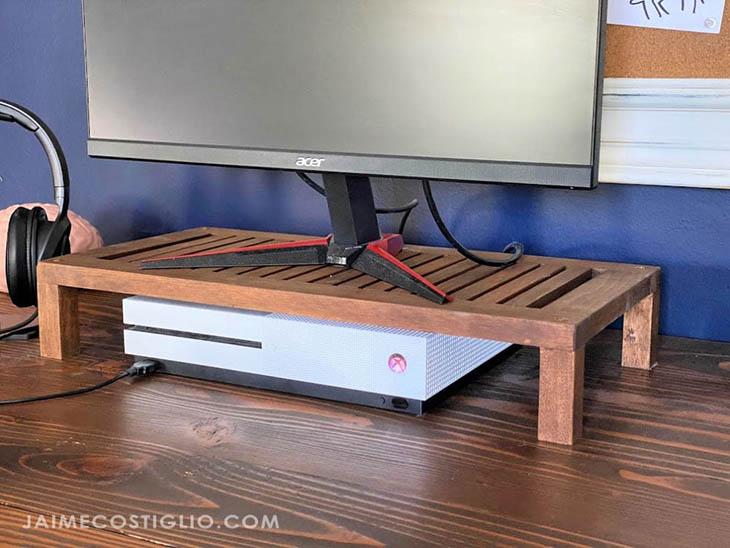 slatted computer riser sitting on a desk