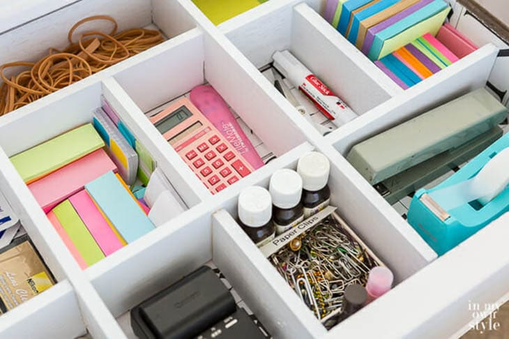 drawer divider with desk supplies in all the sections