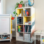 Learn how to make your own home-office, back to school, or homeschool organizer with this easy DIY Ikea Kallax Shelf hack. The DIY built-in inserts are perfect for organizing paper and folders.