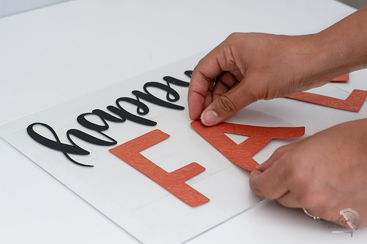 Applying letters to plexiglass