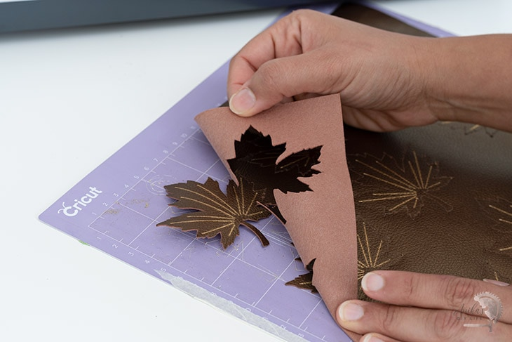 removing faux leather from Cricut mat to make a fall wreath