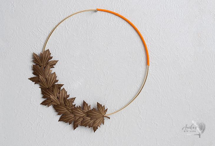 DIY minimal and modern fall hoop wreath on wall