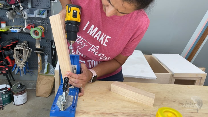 Woman making pocket holes for the bench